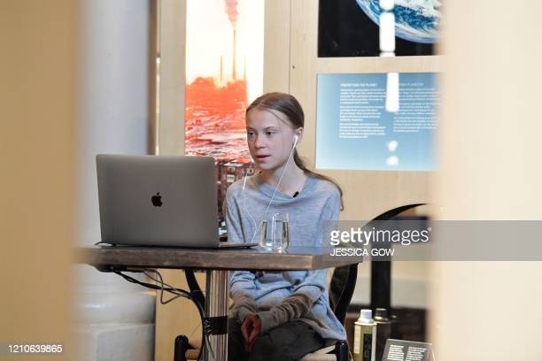Swedish climate and environmental activist Greta Thunberg is seen in video conversation with Swedish Professor and joint director of the Potsdam...
