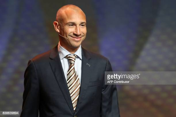 Swedish coach and former football player Henrik Larsson arrives to attend the draw for the UEFA Europa League football group stage 2017/18 on August...