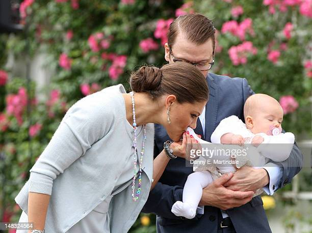 Swedish Crown Princess Victoria kisses the foot of Princess Estelle as Prince Daniel holds their her during her 35th birthday at Solliden on July 14,...