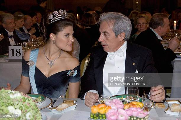 Swedish Crown Princess Victoria listens to French physics laureate Albert Fert, at the Nobel banquet at the Town Hall, Stockholm, Sweden, 10...