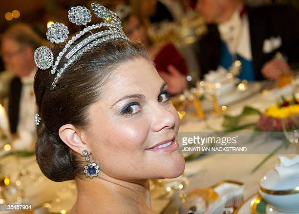 Swedish Crown Princess Victoria smiles at the honorary table during the Nobel banquet following the Nobel Prize award ceremony held at the Stockholm...