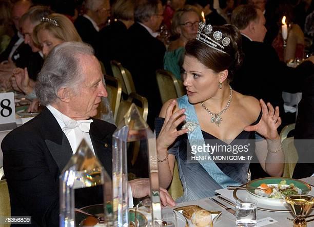 Swedish Crown Princess Victoria, talks to US medicine laureate Mario R. Capecchi, at the Nobel banquet at the Town Hall, Stockholm, Sweden, 10...