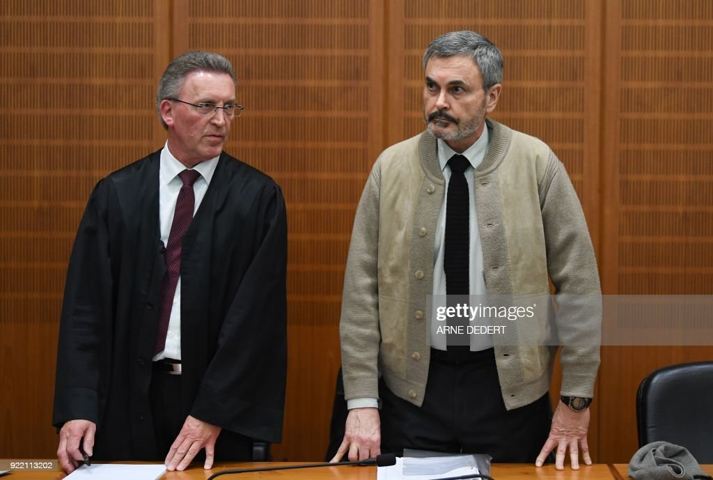 Swedish defendant John Ausonius (R), also know as 'Laser man', accused for the murder of 68-year-old Jewish Holocaust survivor Blanka Zmigrod in Frankfurt in 1992, stands next to his Lawyer as he arrives for his trial in a courtroom at court in Frankfurt am Main, western Germany, on February 21, 2018. The court on February 21, 2018 jailed for life the convicted killer, dubbed 'the laser man' for using a laser-scoped rifle to target immigrants, for the murder of the Jewish woman. John Ausonius, 64, has already received a life prison term in Sweden for a six-month shooting spree in 1991-92 in which he killed or wounded 11 immigrants. PHOTO / dpa / Arne Dedert / Germany OUT
