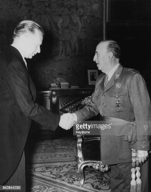 Swedish diplomat Dag Hammarskjold SecretaryGeneral of the United Nations is greeted by Spanish dictator General Franco at the El Pardo Palace in...