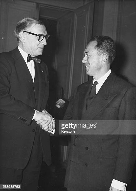 Swedish diplomat Ragnar Kumlin shaking congratulating author Albert Camus for his Nobel Prize in Literature award at the Swedish Academy October 17th...
