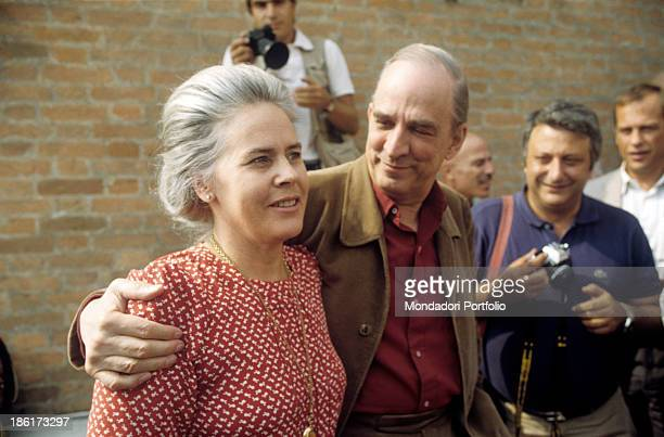 Swedish director and scenarist Ingmar Bergman hugging his wife Ingrid von Rosen in front of the photographers at the 40th Venice International Film...