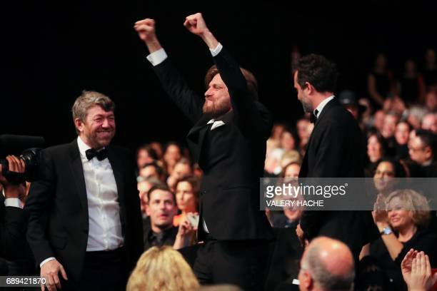 Swedish director Ruben Ostlund reacts after he was awarded with the Palme d'Or for his film 'The Square' on May 28 2017 during the closing ceremony...