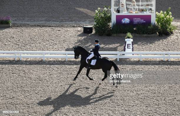 Swedish dressage rider Therese Nilshagen riding Dante Weltino in the dressage Grand Prix at the Longines FEI European Championships 2017 in...