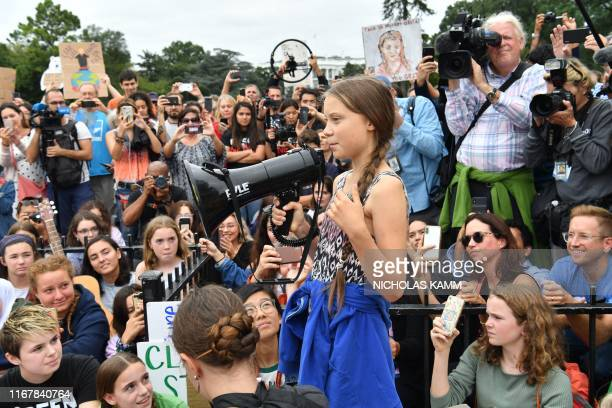 TOPSHOT Swedish environment activist Greta Thunberg speaks at a climate protest outside the White House in Washington DC on September 13 2019...