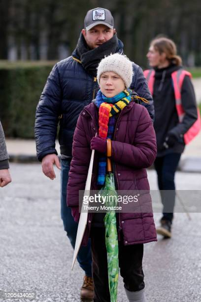 Swedish environmental activist Greta Thunberg is walking away at the end of the walk 'strike for climate on March 6 in Brussels Belgium