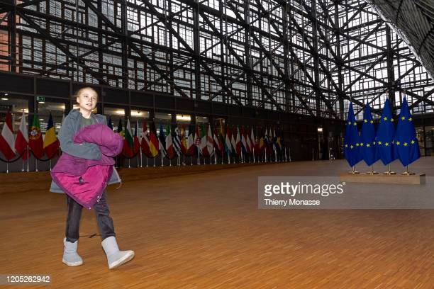 Swedish environmental activist on climate change Greta Thunberg is talking to media as she arrives for an EU environment Council at the Europa the...