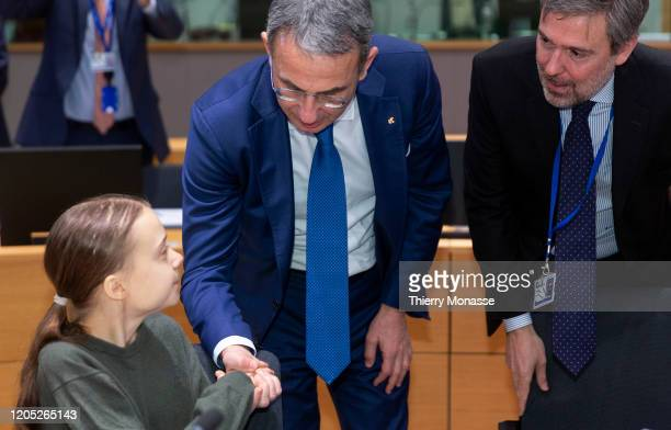Swedish environmental activist on climate change Greta Thunberg greets the Italian Minister for Environment and Land and Marine Protection Sergio...