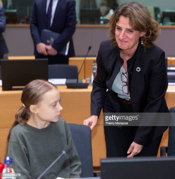 Swedish environmental activist on climate change Greta Thunberg greets the Spanish Minister for the Ecological Transition Teresa Ribera Rodriguez...