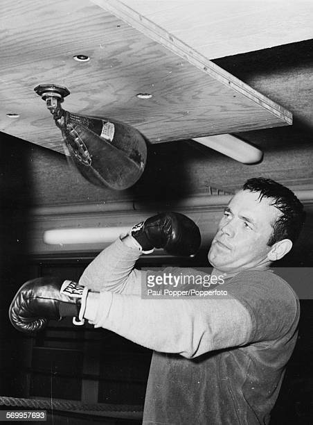 Swedish european heavyweight champion boxer Ingemar Johansson works out on a punch bag during a training session at his local club in Gothenburg...