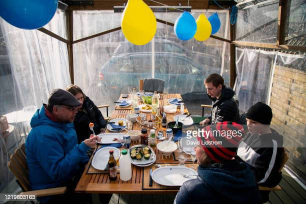 Swedish family eats dinner together despite the fear around the world of spreading the Coronavirus on April 18 2020 in Ostersund Sweden Sweden has...