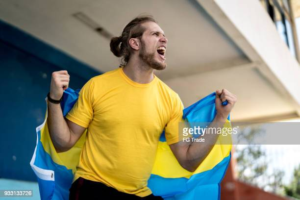 swedish fan watching a soccer game - fan enthusiast stock pictures, royalty-free photos & images