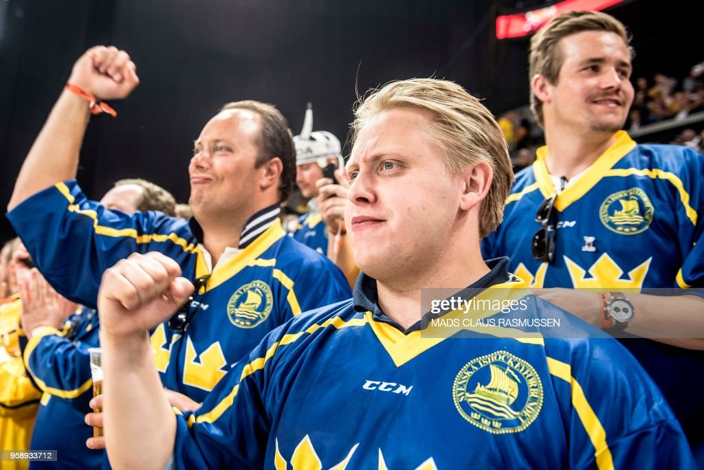 Swedish fans cheer during the IIHF World Championship group A ice hockey match between Russia and Sweden in Royal Arena in Copenhagen, on May 15, 2018. (Photo by Mads Claus Rasmussen / Ritzau Scanpix / AFP) / Denmark OUT