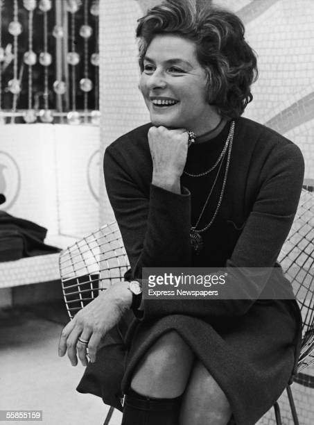 Swedish film and theater actress Ingrid Bergman sits on a wire chair with her hand on her chin and laughs London January 6 1971 Bergman was in London...