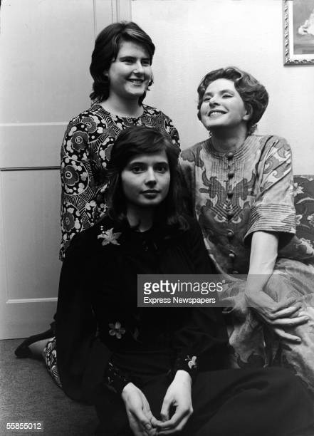 Swedish film and theater actress Ingrid Bergman sits with her twin daughters actress Isabella and academic Ingrid after Bergman's performance as Lady...