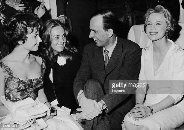 Swedish film director Ingmar Bergman director of the Malmoe Theatre poses with actresses Gunnel Lindblom Jeanne Moreau and Bibi Andersson during a...
