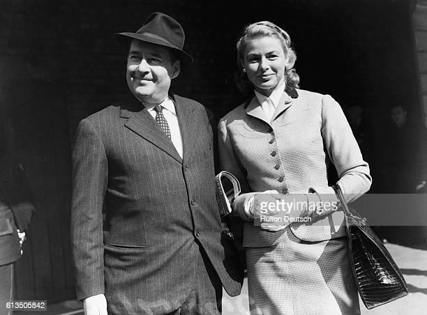 Swedish film star Ingrid Bergman and her husband Italian film director Roberto Rossellini at Victoria Station in 1956