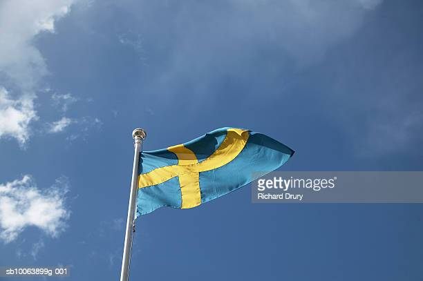 swedish flag against sky, low angle view - richard drury stock pictures, royalty-free photos & images