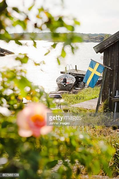 Swedish flag and boats moored at coast
