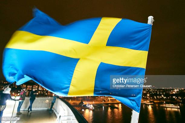 Swedish flag blowing in wind at night