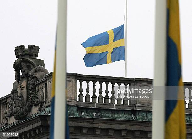 Swedish flags outside the Foreign Ministry and on top of the Riksdag the parliament building in Stockholm are lowered to halfmast 01 January 2005 as...