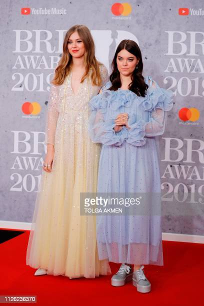 Swedish folk duo 'First Aid Kit' Johanna Soderberg and Klara Soderberg pose on the red carpet on arrival for the BRIT Awards 2019 in London on...