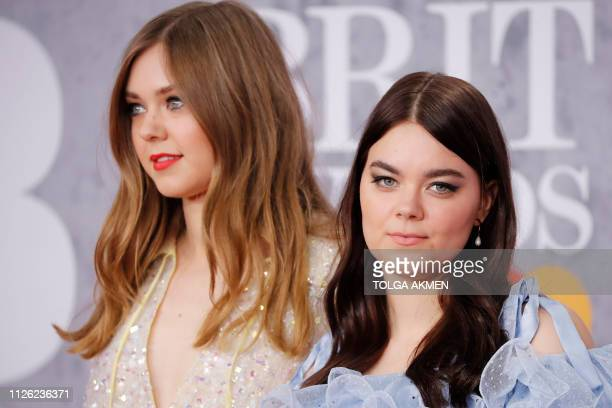 Swedish folk duo 'First Aid Kit', Johanna Soderberg and Klara Soderberg pose on the red carpet on arrival for the BRIT Awards 2019 in London on...