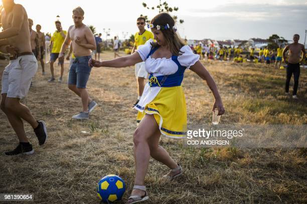TOPSHOT Swedish football fans celebrate midsummer outside the Fisht Olympic stadium in Sochi on June 22 on the eve of the Russia 2018 FIFA World Cup...