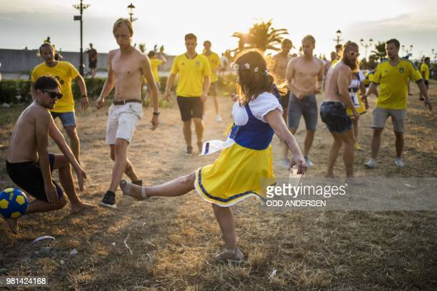 Swedish football fans celebrate midsummer outside the Fisht Olympic stadium in Sochi on June 22 on the eve of the Russia 2018 FIFA World Cup Group F...