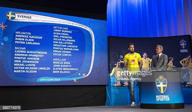 Swedish football player Emir Kujovic stands near Sweden's head coach Erik Hamren as Hamren presents the Swedish team for the UEFA European...