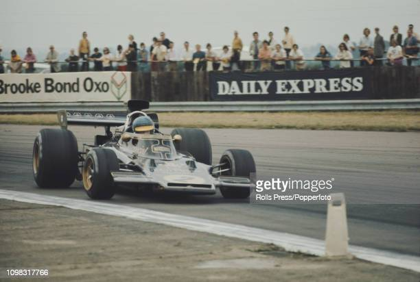 Swedish Formula One racing driver Ronnie Peterson drives the John Player Team Lotus Lotus 72E Ford Cosworth DFV V8 with characteristic high speed...