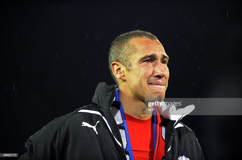 Swedish forward Henrik Larsson of Helsingborg reacts after he is thanked by his fans after his last soccer match, a Swedish league match between Helsingborgs IF and Djurgardens IF at the Olympia stadium in Helsingborg, on October 28, 2009. After an international career in which he played also for Feyenoord, Celtic, Barcelona and Manchester United clubs, Larsson is to retire after tonight's match.