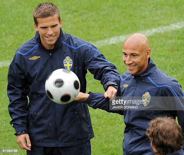 Swedish forward Marcus Allback and Swedish forward Henrik Larsson jokes during a training session on June 17, 2008 at Tivoli Neu stadium in...