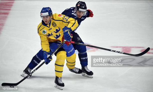 Swedish forward Michael Lingqvist vies with Finnish forward Henri Ikonen during the Channel One Cup of the Euro Hockey Tour ice hockey match between...