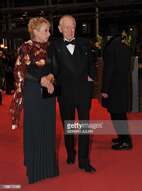 Swedish French actor Max von Sydow and his wife Catherine Brelet pose for photographers on the red carpet at the premiere of the film Extremely Loud...
