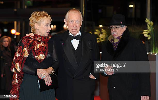 Swedish- French actor Max von Sydow and his wife Catherine Brelet pose with Berlinal Festival director Dieter Kosslick for photographers on the red...