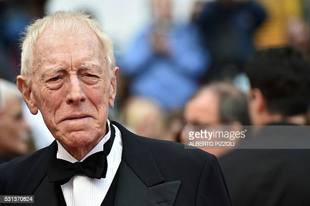 Swedish French actor Max von Sydow pose on May 14 2016 as they arrive for the screening of the film The BFG at the 69th Cannes Film Festival in...