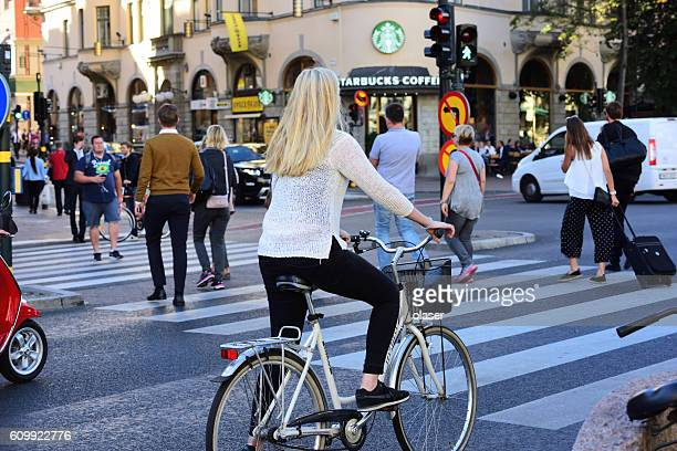 Swedish girl and bicycle, Stockholm traffic in background