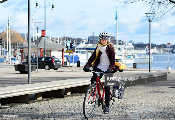 Swedish girl and bicycle, traffic in background