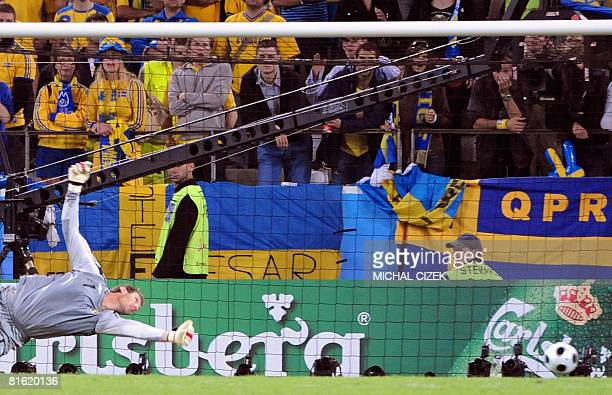 Swedish goalkeeper Andreas Isaksson eyes the ball after the goal of Russian forward Andrei Arshavin during the Euro 2008 Championships Group D...