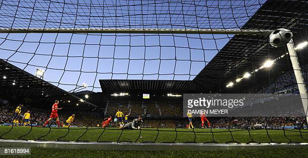 Swedish goalkeeper Andreas Isaksson eyes the ball in the net after the goal of Russianforward Roman Pavlyuchenko during the Euro 2008 Championships...