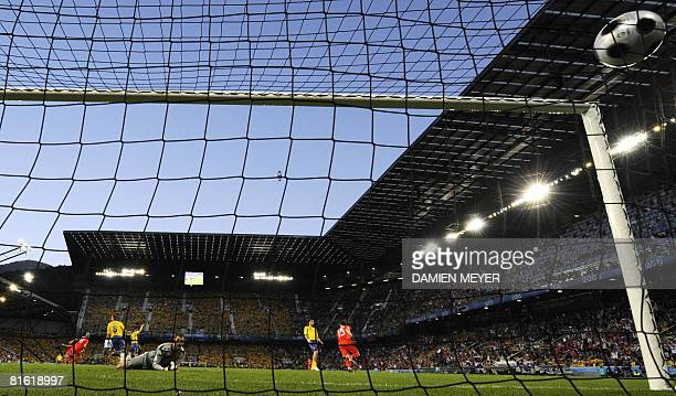 Swedish goalkeeper Andreas Isaksson eyes the ball in the net after the goal of Russian forward Roman Pavlyuchenko during the Euro 2008 Championships...
