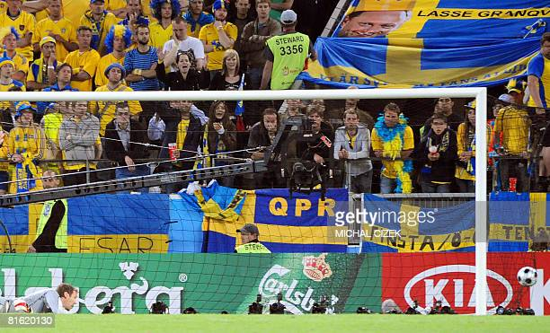 Swedish goalkeeper Andreas Isaksson eyes the ball in the net after the goal of Russian forward Andrei Arshavin during the Euro 2008 Championships...