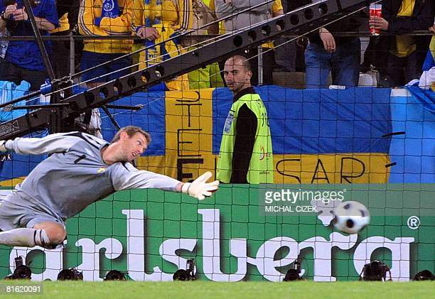 Swedish goalkeeper Andreas Isaksson fails to save a goal shot by Russian forward Andrei Arshavin during the Euro 2008 Championships Group D football...