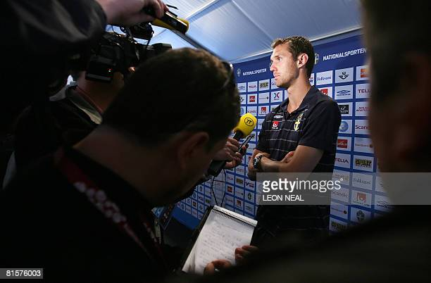 Swedish goalkeeper Andreas Isaksson talks to members of the media following a training session at the Swedish training camp in Lugano Switzerland on...