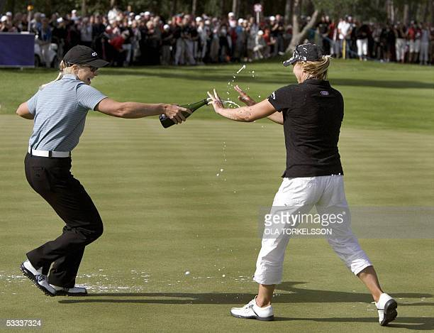 Swedish golfer Annika Sorenstam is chased with champagne by her sister Charlotta Sorenstam after winning the Scandinavian TPC golf tournament at the...